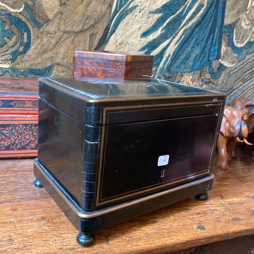Cigar box of rectangular shape in black tinted wood and ornamented with brass ne…