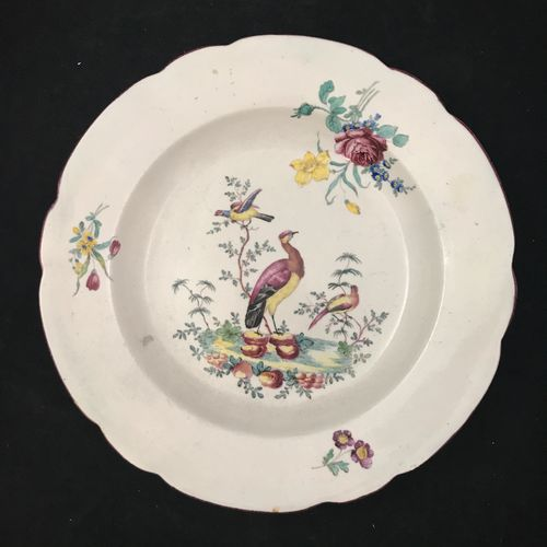 Tournay. Porcelain plate the marli decorated with bouquets of cut flowers, the b…