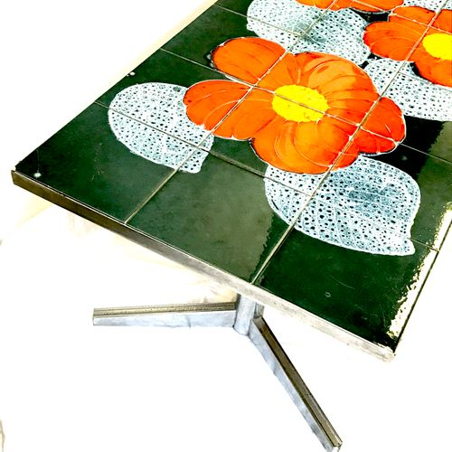A coffee table, the rectangular tray in earthenware squares (a crack) with flora…