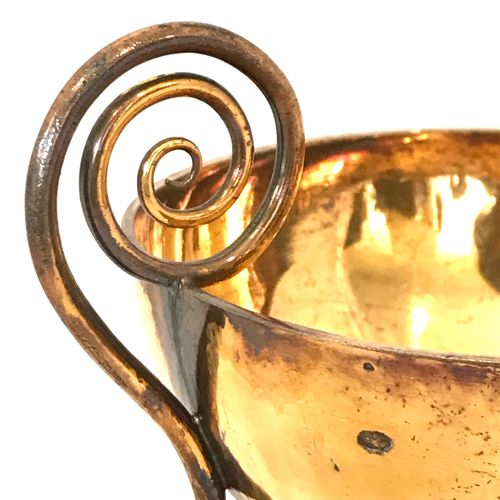 A vermeil cup, the grip spiral, the pedestal decorated with a frieze of palms. H…