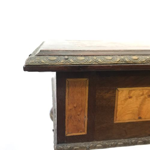 A small Louis XVI style working table, the top inlaid with cubic motifs, brass f…