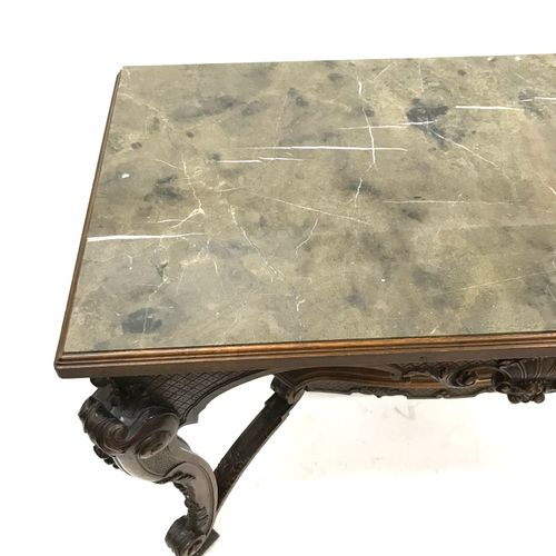 A richly carved console table with a Louis XV style marble top. Height 79 cm. Le…
