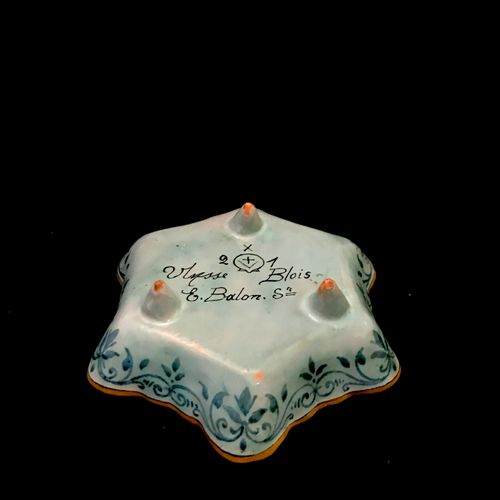 Blois ULYSSES A polychrome earthenware hexagonal dish with three feet, decorated…