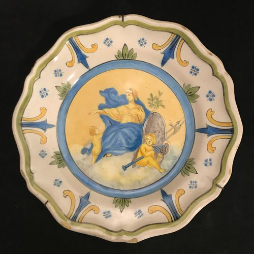Polychrome earthenware plate from Nevers (?). 19th century. Diameter : 24,1 cm. …