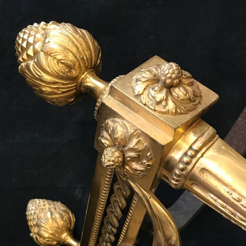A pair of Louis XVI style chased and gilt bronze andirons decorated with ribbons…