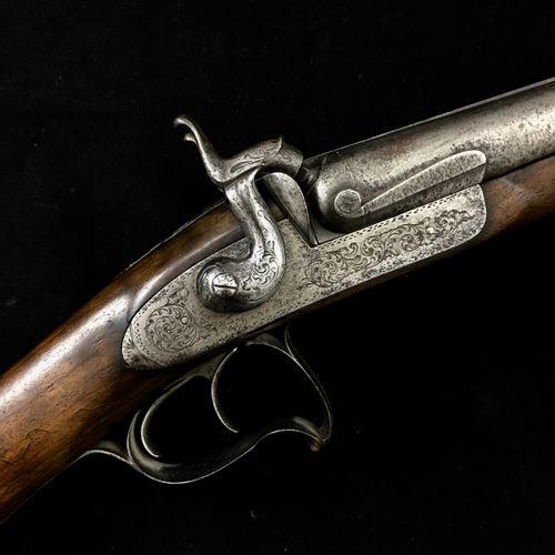 """Un fusil de chasse à percussion, à canons juxtaposés, marqué """"Charton et fils"""". …"""