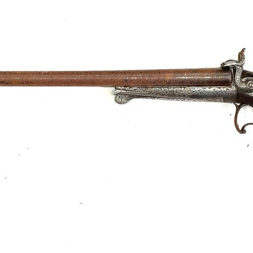 Fusil de chasse à broche, canons en table Damas de 68,5 cm calibre 16, mécanisme…