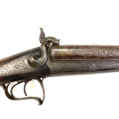 Fusil de chasse à broche, canons en table Damas de 64,5 cm calibre 12, mécanisme…