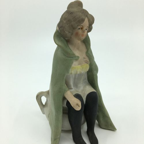 BISCUIT polychrome. Young woman, on her pot, second half of the 19th century. He…