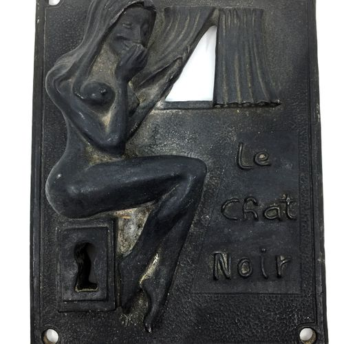 DOOR PLATE. The Black Cat, circa 1900. Cast iron peephole where a naked, laughin…