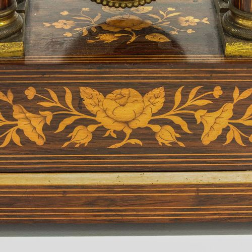 A Column Pendule 19th century, with beautiful marquetry, height 51 cm.