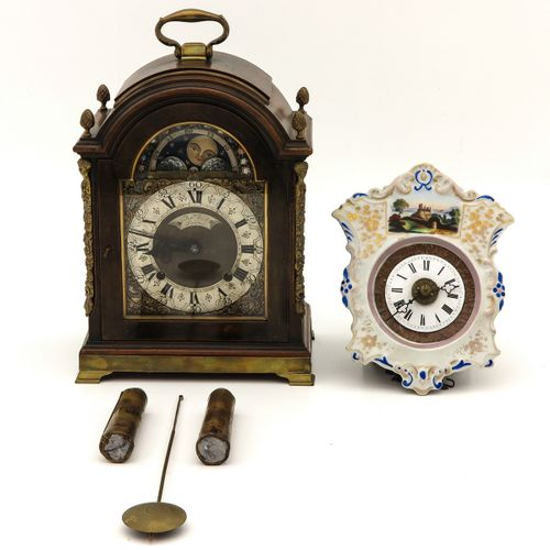 Table Clock and Wall Clock consisting of an English table clock, signed Rob Wood…