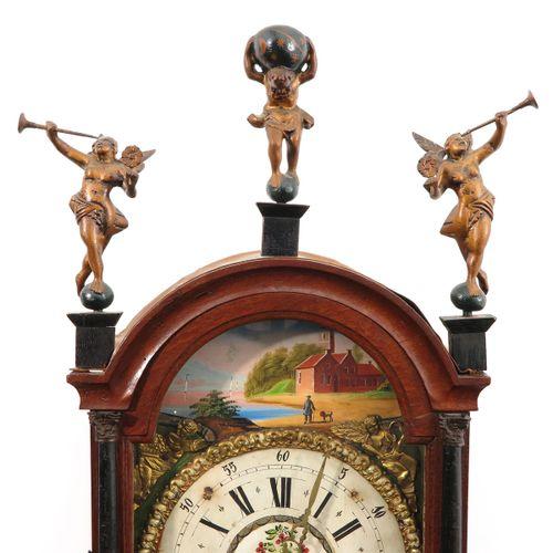 A Dutch Wall Clock Friesland, 19th century, length 127 cm.