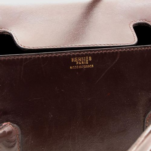 A Ladies Bag marked Hermes, brown leather, 26 cm. Wide