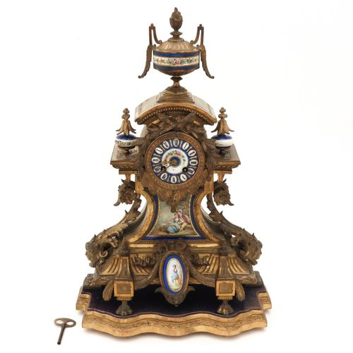 A French Pendule Napolen III, with Limoges plaques, height 53 cm.