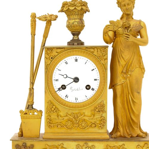 A French Pendule fire gilded, France, 19th century, depicting the goddess of agr…
