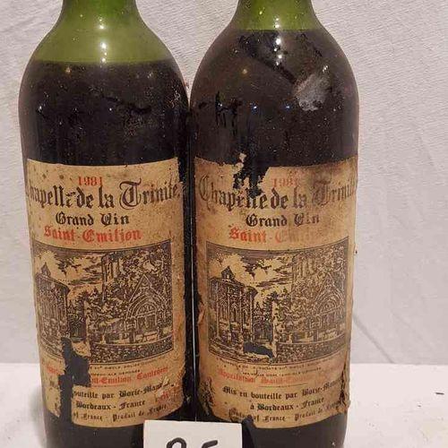 2 bouteilles CHAPELLE DE LA TRINITE 1981 SAINT EMILION. Etiquettes tachées et dé…