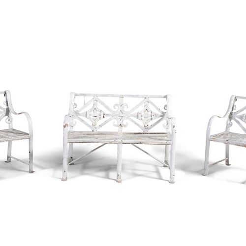 AN UNUSUAL WROUGHT IRON CHILD'S SUITE OF GARDEN FURNITURE, comprising a three se…