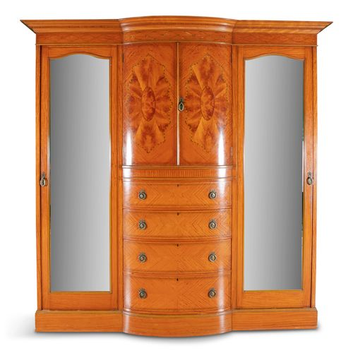 AN EDWARDIAN INLAID SATINWOOD BOWFRONT WARDROBE, a moulded dentil cornice above …