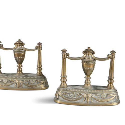 A PAIR OF BRASS CHENETS, in the neo classical taste, each with central urns and …