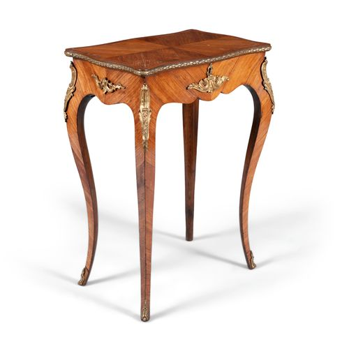 A FRENCH KINGWOOD AND ORMOLU MOUNTED LIFT TOP TABLE, 19th century, with quarter …