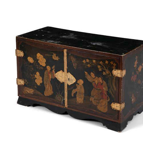 A CHINESE LACQUERED TWO DOOR CABINET, c,1900, decorated in gilt with figures, bu…