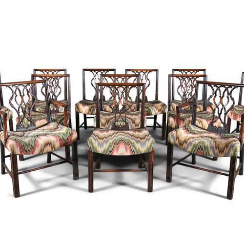 A SET OF TWELVE GEORGE III MAHOGANY DINING CHAIRS, comprising two carvers and te…