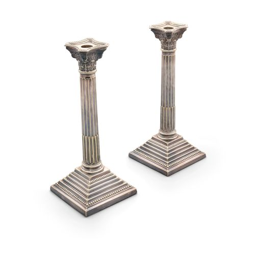 A PAIR OF SILVER PLATED TABLE CANDLESTICKS, of Corinthian column form, raised on…