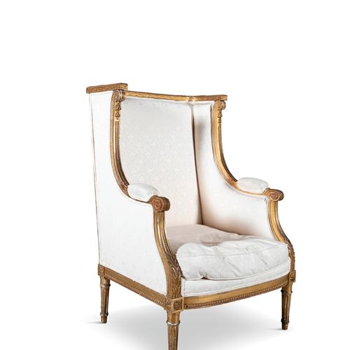 A FRENCH GILTWOOD FAUTEUIL A L'OREILLES, late 19th century, in the Louis XVI sty…