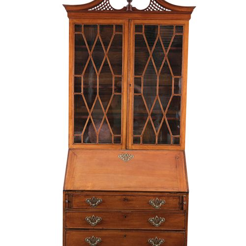 A GEORGE III MAHOGANY SLOPEFRONT BUREAU BOOKCASE, with broken swan neck pediment…