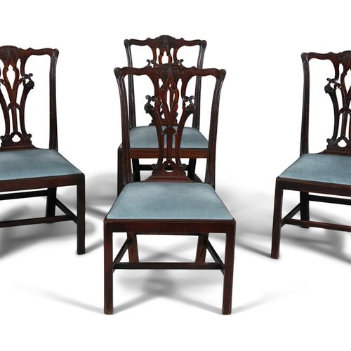 A SET OF FOUR GEORGE III MAHOGANY DINING CHAIRS, each with pierced splat back, f…