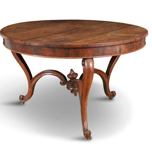 A ROSEWOOD LIBRARY TABLE, mid 19th century, of circular form, on three scroll ca…