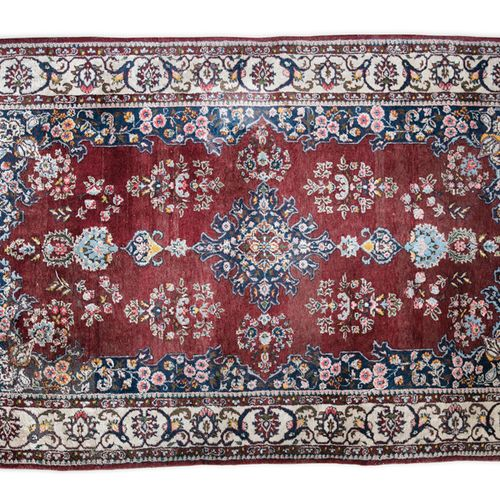 A PERSIAN SILK RUG of rectangular form with lozenge shaped centre field in clare…
