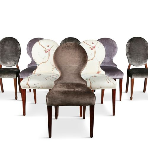 A MATCHED SET OF EIGHT MAHOGANY FRAMED MODERN UPHOLSTERED DINING CHAIRS, the pad…