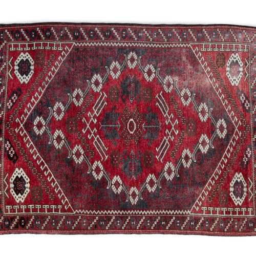A TURKISH RED GROUND RUG, of rectangular shape woven with central medallion with…
