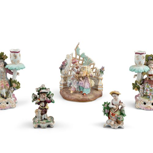 A PAIR OF 'CHELSEA' STYLE BROCADE FIGURAL CANDLE STICKS, 19th century, of a gent…