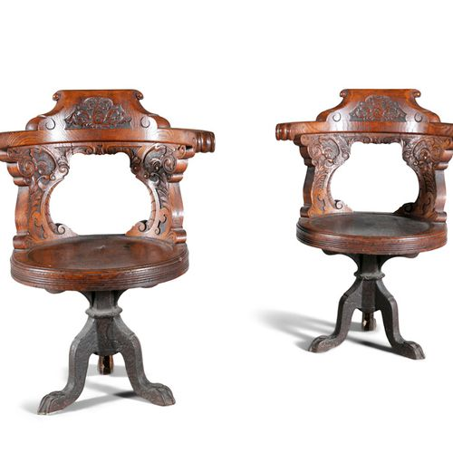 A PAIR OF HEAVY CARVED STAINED OAK TUB ELBOW HALL CHAIRS, with panels of foliate…