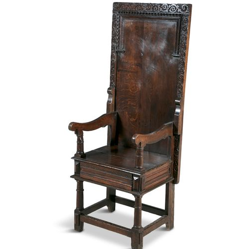 A 17TH CENTURY OAK MONK'S CHAIR, with hinged back converting to a table, of heav…