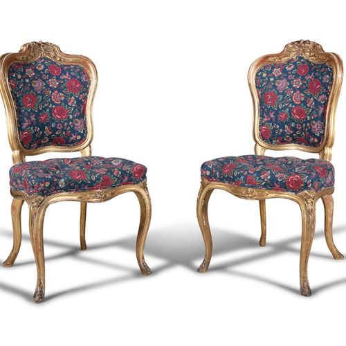 A PAIR OF ENGLISH 19TH CENTURY GILTWOOD SALON CHAIRS, each with curved panel bac…