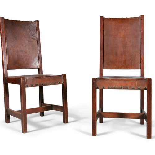 A PAIR OF OAK AND LEATHER UPHOLSTRED SIDE CHAIRS, late 19th century, attributed …