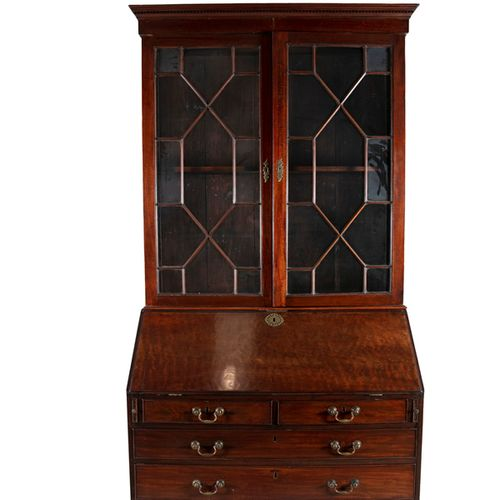 A COMPOSED GEORGE III STYLE MAHOGANY BUREAU BOOKCASE, with moulded dentil cornic…