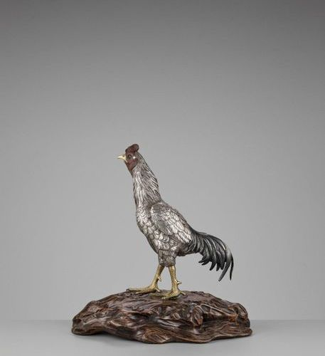 SEIYA: AN UNUSUAL AND RARE PARCEL GILT SILVERED BRONZE OKIMONO OF A COCKEREL By …