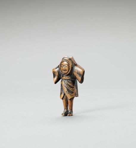 A CHARMING WOOD NETSUKE OF A BOY IMITATING A SCARECROW Unsigned Japan, early 19 …