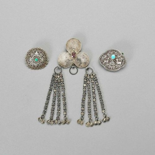 A GROUP OF THREE SILVER AND SILVER PLATE BELT ORNAMENTS China and Tibet, 1900 – …