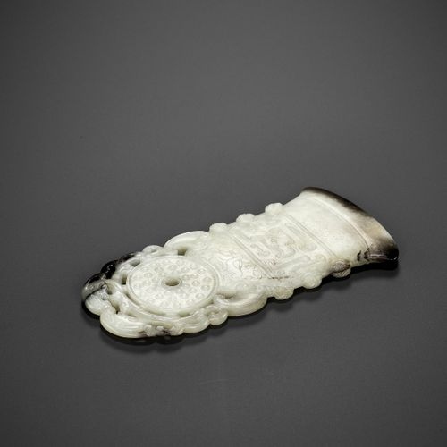 A BLACK AND WHITE JADE 'ARCHAISTIC' AXE FORM OPENWORK PENDANT, 18 CENTURY China.…