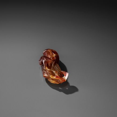 A FINE AGATE 'MELON AND BOY' GROUP, QING China, 1750 1850. Carved as two melons …