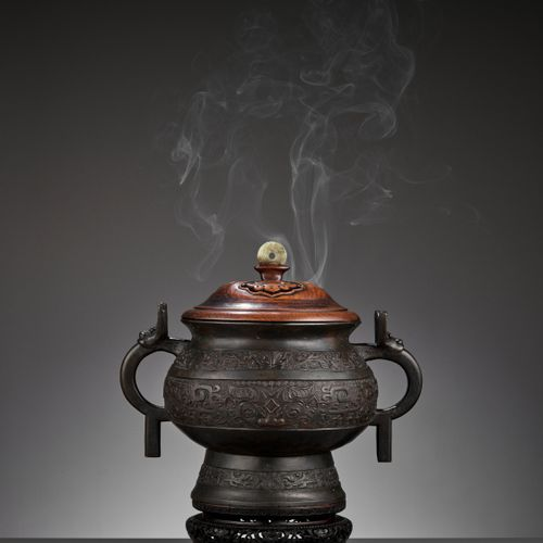 AN ARCHAISTIC BRONZE GUI FORM CENSER, QING DYNASTY China, 18 th 19 th century. T…
