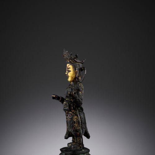 A PARCEL GILT BRONZE FIGURE OF VAISRAVANA, MING DYNASTY China, 1368 1644. The ch…