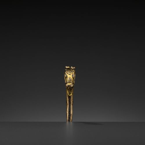 A GILT BRONZE 'LONGMA' HILT, MING DYNASTY China, 1368 1644, Xuande period (1426 …