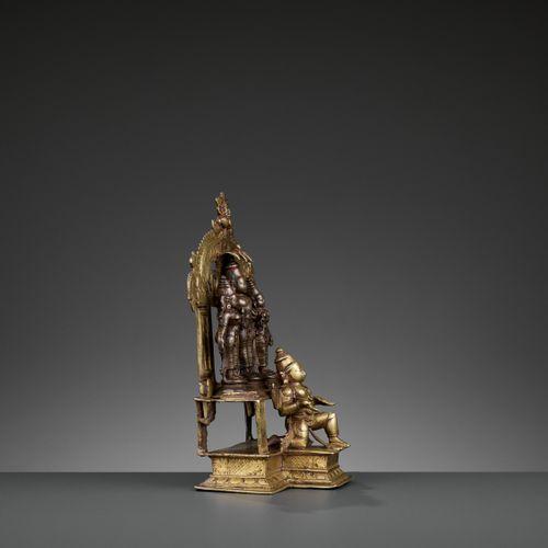 A BRONZE TRIAD OF VISHNU, SHRIDEVI AND BHUDEVI ON A GARUDA SHRINE, VIJAYANAGAR P…